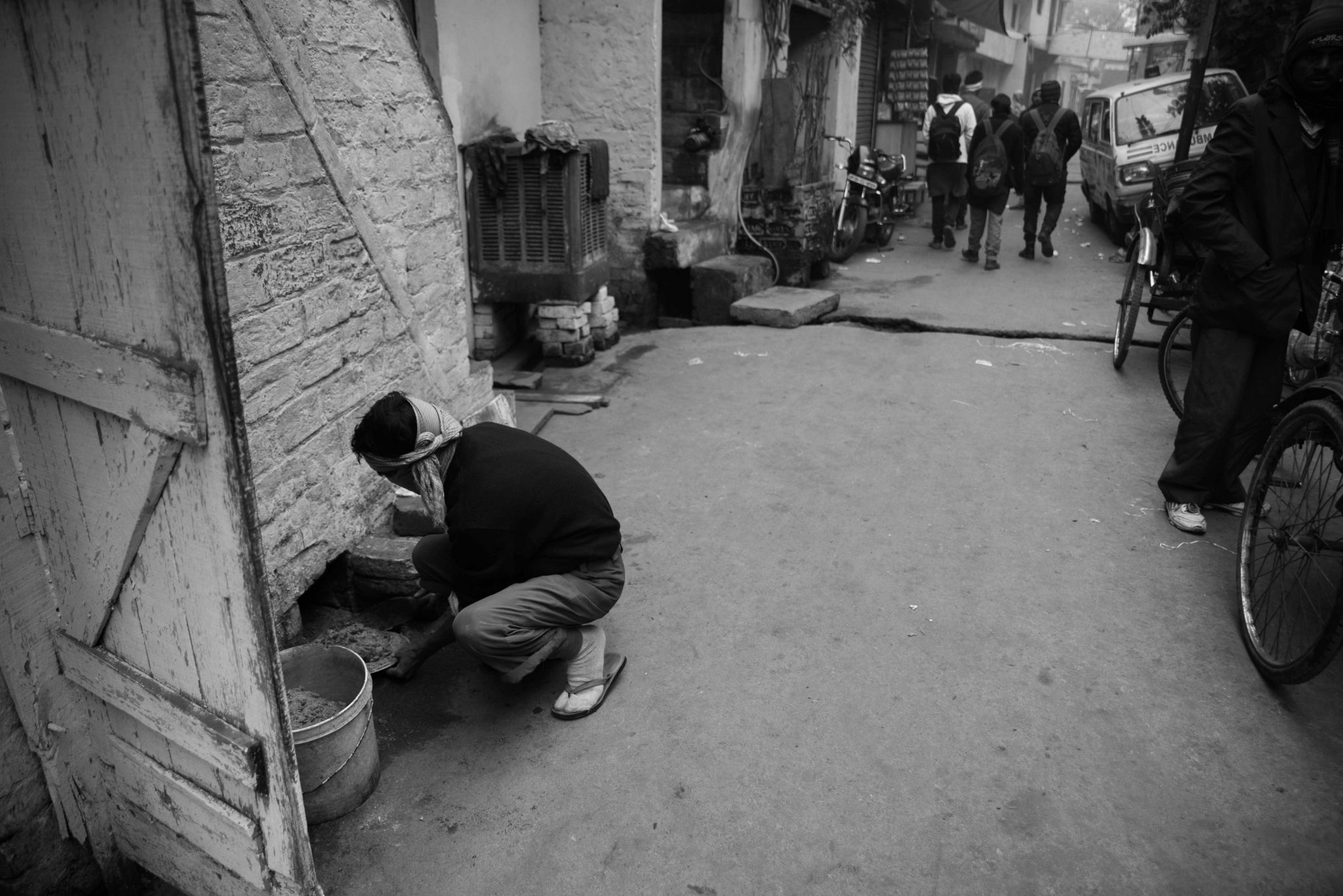 Rajan cleans a 'dry' latrine